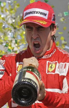 Fernando Alonso celebrates after finishing third in Brazil last weekend.