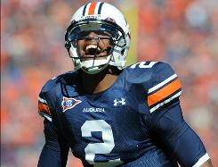 Cam Newton and Auburn face Georgia  with a chance to clinch the SEC's Western Division title.
