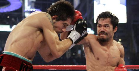 Manny Pacquiao, right, lands a right against Antonio Margarito during the second round of their WBC super welterweight title fight in Arlington, Texas. Pacquiao won by unanimous decision.