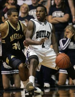 Shelvin Mack, right, and Butler started the 2010-11 season by knocking off Brandon Malone and Marian at Hinkle Fieldhouse.