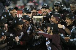 Members of the Colorado Rapids celebrate after winning the MLS' Eastern Conference championship by defeating the San Jose Earthquakes.
