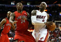 Forward LeBron James of the Miami Heat drives against Sonny Weems of the Toronto Raptors on Saturday.