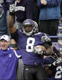 Northwestern wide receiver Demetrius Fields celebrates after his game-winning touchdown against Iowa.