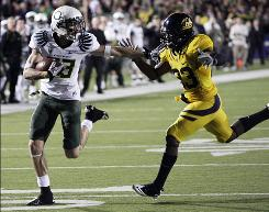 Oregon's Jeff Maehl holds back Cal cornerback Josh Hill to score a third-quarter touchdown as the Ducks stayed unbeaten.