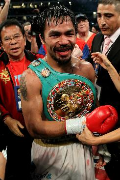 Manny Pacquiao celebrates after he being declared the winner by unanimous decision against Antonio Margarito in their WBC super welterweight title bout at Cowboys Stadium in Arlington, Texas.
