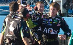 Carl Edwards exchanges high-fives with his No. 99 crew after his victory at Phoenix International Raceway.