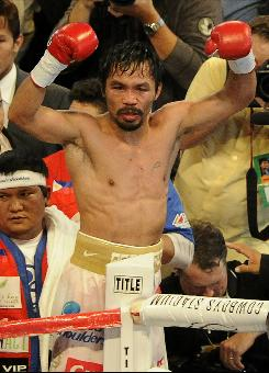 Manny Pacquiao of the Philippines celebrates after defeating Antonio Margarito of Mexico in their WBC World Super Welterweight title fight at Cowboys Stadium in Arlington, Texas on Saturday.