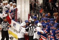 Fights erupt in front of both benches during the New York Rangers' 8-2 rout of the Edmonton Oilers on Sunday afternoon.