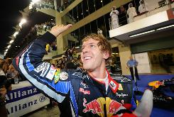 Red Bull Racing's Sebastian Vettel waves to fans after winning the Abu Dhabi Grand Prix and the Formula One title.