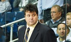 Interim New York Islanders coach Jack Capuano, shown behind the bench of the Sound Tigers, is a player's coach who has no qualms about occasionally snapping.