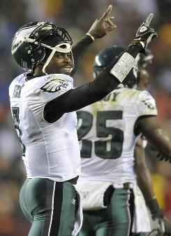 Philadelphia Eagles quarterback Michael Vick threw a touchdown on the first play from scrimmage against the Washington Redskins at FedEx Field.