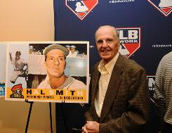 Hal Smith, posing with an enlargement of his Pirates baseball card, hit a key three-run homer in Game 7 of the 1960 World Series.
