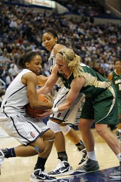 Connecticut guard Lorin Dixon (left) and forward Maya Moore (center) work for the ball during the first half against Baylor guard Melissa Jones at the XL Center.
