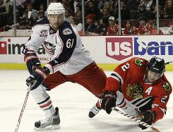 Defending Norris Trophy champion Duncan Keith, right, has a minus-6 rating this season.