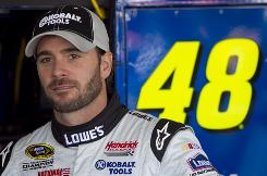 Jimmie Johnson takes a break before practice sessions at Phoenix International Raceway.