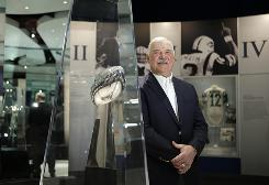 Baby Boomer Larry Csonka is among a group of former professional sports stars who have settled into new careers or retirement as they approach Social Security age. The former running back, shown here in the Pro Football Hall of Fame, is a member of the undefeated 1972 Miami Dolphins.