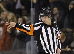 Referee Marcus Vinnerborg signals a goal by Stars center Brad Richards following a video review in the third. The game marked the debut of Swedish referee, who became the first European to work an NHL game.