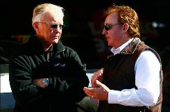 Team owners Joe Gibbs, left, and Richard Childress, along with Rick Hendrick (not seen) want the Sprint Cup championship decided on the track at Homestead-Miami Speedway, not with a late caution.