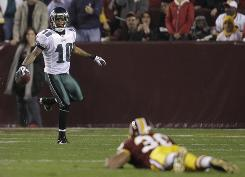 DeSean Jackson, left, and the Eagles scored early and often in a 59-28 win against the Redskins on Monday.
