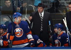 Islanders interim coach Jack Capuano, giving instructions to his bench during his team's loss to the Lightning, watched New York suffer its 11th consecutive loss.