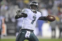 "The Eagles' Michael Vick, attempting a pass during second half of Monday's game against the Redskins, says he's ""moving forward"" from his troubled past."