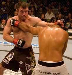 Matt Hughes, facing camera, defeated BJ Penn in their September 2006 rematch.