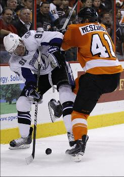 Steven Stamkos, taking a check into the boards from the Flyers' Andrej Meszaros during the first period, notched his second hat trick of the season for the Lightning.