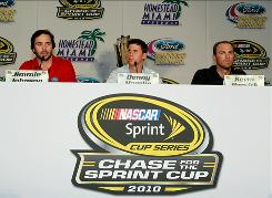Jimmie Johnson, left, Denny Hamlin, and Kevin Harvick speak to the media during the NASCAR Championship Contenders press conference Thursday in Coral Gables, Florida.