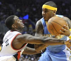 The Denver Nuggets' Carmelo Anthony drives against the Portland Trail Blazers' Wesley Mathews during the first half on Thursday.