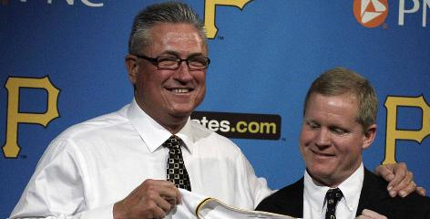 "Clint Hurdle, left, is introduced as the 39th manager in Pirates history by general manager Neil Huntington. Said Hurdle: ""I wanted to get on board now."""