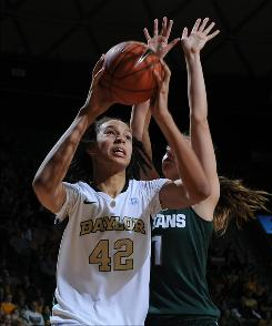 Brittney Griner, trying to shoot over Michigan State's Annalise Pickrel during the second half of their hoops game, scored 29 points for Baylor.