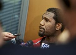 Greg Oden talks to the press last winter.