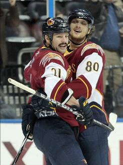 Thrashers center Nik Antropov, right, celebrates with teammate Ben Eager after a first-period goal as Atlanta blanked the Capitals.
