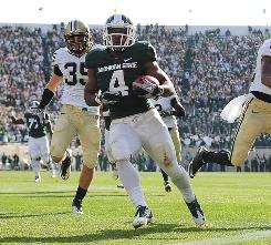 Michigan State running back Edwin Baker runs for a touchdown during the second quarter against Purdue