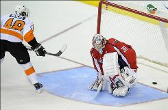 Flyers center Danny Briere beats Capitals goalie Michal Neuvirth, scoring the lone goal of the shootout, to send Philadelphia to a 5-4 win.