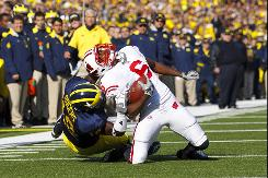 Wisconsin wide receiver Isaac Anderson is tackled by Michigan's James Rogers Saturday when the Badgers beat Michigan 48-28. Wisconsin remains in contention for the Big Ten title and a Rose Bowl berth.