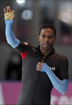 U.S. speedskater Shani Davis reacts after winning the men's 1,000-meter race at a World Cup speedskating event in Berlin.