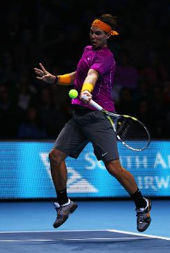 Rafael Nadal of Spain lines up a forehand during his three-set victory against Andy Roddick of the US on Monday in the ATP World Tour Finals in London.