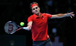 Roger Federer of Switzerland lashes a forehand during his 6-4, 6-2 victory against Andy Murray of Great Britian on tuesday at the ATP World Tour Finals in London.