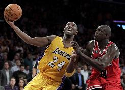 Lakers shooting guard Kobe Bryant drives to the basket against Bulls small forward Luol Deng during the second half on Tuesday. Bryant finished with 20 points and the Lakers won 98-91.