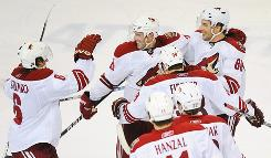 Eric Belanger, center, and the rest of his Coyotes teammates have been doing a lot of celebrating recently.