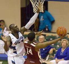 Chaminade center Mamadou Diarra, left, attempts to block a shot by Oklahoma guard Carl Blair.