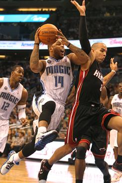 Orlando Magic guard Jameer Nelson drives to the basket as Miami Heat guard Carlos Arroyo defends during the Magic's 104-95 victory at Amway Center in Orlando.