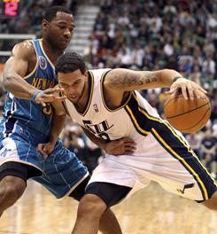 Utah Jazz guard Deron Williams, right, works to get past New Orleans Hornets guard Willie Green during the second half of the Jazz's 105-87 win over the Hornets in Salt Lake City on Wednesday.