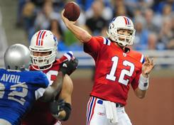 Patriots quarterback Tom Brady threw a season-high four touchdowns to down the Lions on Thanksgiving Day.