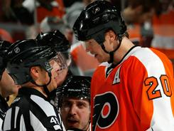 Flyers defenseman Chris Pronger argues his unsportsmanlike call with referee Ghislain Hebert.