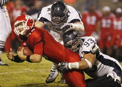 Fresno State's Ryan Colburn is sacked by Nevada's Brett Roy and Zach Madonick in the first half of the Wolf Pack's Nov. 13 victory.