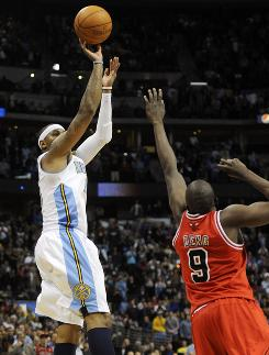 Denver Nuggets forward Carmelo Anthony hits the game-winning shot over Chicago Bulls forward Luol Deng in the fourth quarter on Friday. The Nuggets won 108-107.