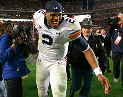 Auburn quarterback Cam Newton celebrates after the Tigers rallied to beat Alabama in Tuscaloosa.