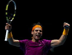 Rafael Nadal of Spain celebrates a point during a contentious first set in his 7-6 (7-3). 6-1 victory against Tomas Berdych of the Czech Republic during the ATP World Tour Finals in London.